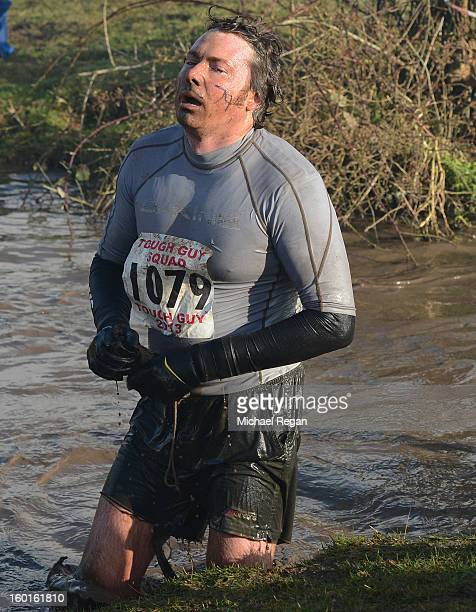 A competitor suffers during the Tough Guy Challenge endurance race on January 27 2013 in Telford England Every year thousands of people run the 8...