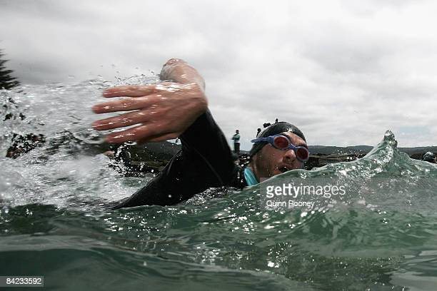 A competitor swims during the Lorne Pier To Pub open water swim at Louttit Bay January 10 2009 in Lorne Australia The Lorne Pier to Pub which began...
