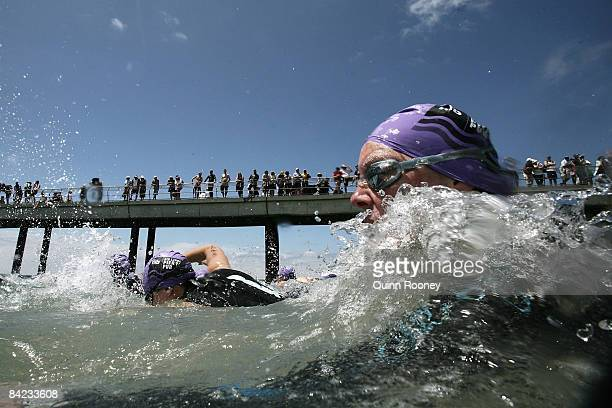 Competitor take to the water for the swim during the Lorne Pier To Pub open water swim at Louttit Bay January 10 2009 in Lorne Australia The Lorne...