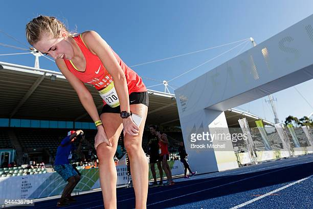 A competitor takes a breath after finishing the the Nike Women's Half Marathon at Sydney Olympic Park on July 3 2016 in Sydney Australia