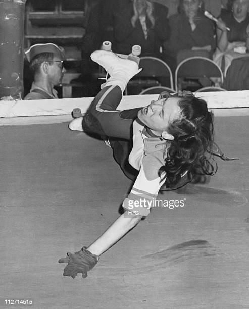 A competitor takes a fall during a roller derby at a New York skating rink 16th November 1953