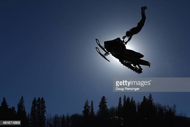 A competitor takes a practice run prior to the snowmobile freestyle finals at Winter XGames 2014 Aspen at Buttermilk Mountain on January 23 2014 in...
