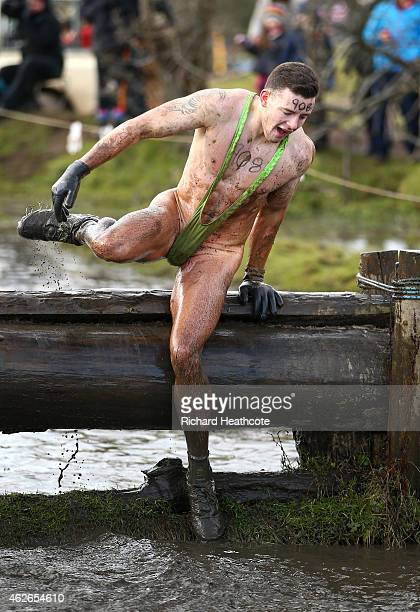 A competitor takes part in a mankini during the Tough Guy Challenge at South Perton Farm on February 1 2015 in Wolverhampton England