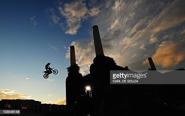 A competitor takes part in a practice session of the Red Bull XFighters motocross championships in front of the British landmark Battersea Power...