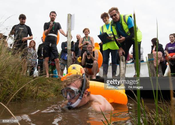 A competitor takes part in the 32nd World Bog Snorkelling Championships at Waen Rhydd peat bog in Llanwrtyd Wells Wales