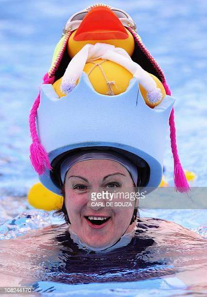 Competitor takes part in the bi-annual Cold Water Championships at Tooting Bec lido outdoor swimming pool, South London on January 22, 2011....