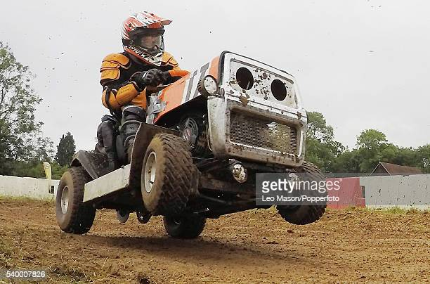 Competitor takes part in the British Lawn Mower Racing - Double 4 Hour race for Class 2, 3 and 4 mower types at Bucks Green on June 12, 2016 in...