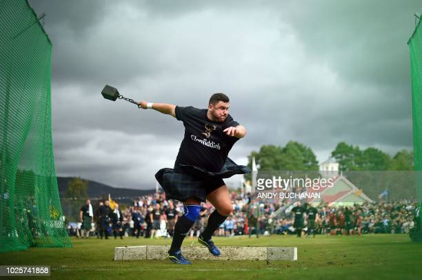 A competitor takes part in the Hammer Throw event at the annual Braemar Gathering in Braemar central Scotland on September 1 2018 The Braemar...