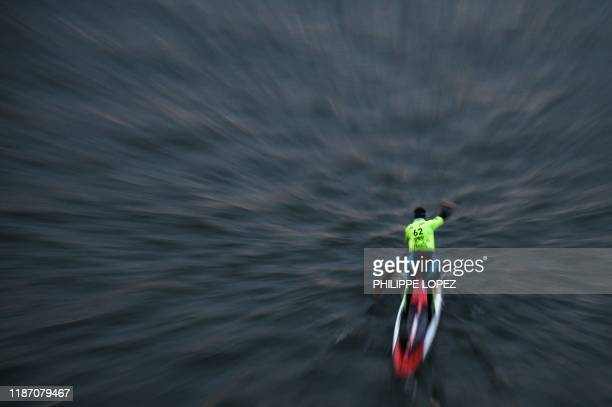 A competitor takes part in the Nautic Paddle Race on the Seine river in Paris on December 8 2019 About 1000 competitors took part in the 11 kilometer...