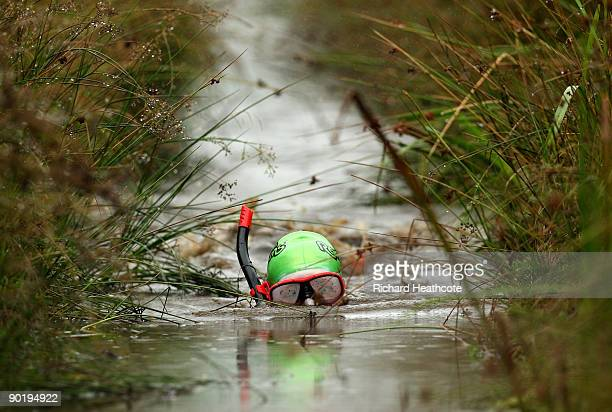 A competitor takes part in the World Bog Snorkelling Championships held at Waen Rhydd Bog on August 31 2009 in Llanwrtyd Wells Wales