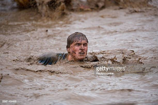 Competitor taking a muddy plunge