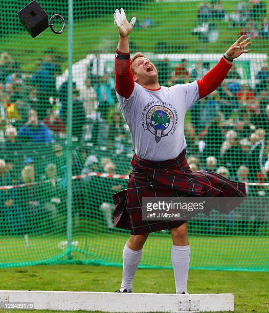 A competitor throws a weight during the during the Braemar Highland Games at The Princess Royal and Duke of Fife Memorial Park on September 3 2011 in...