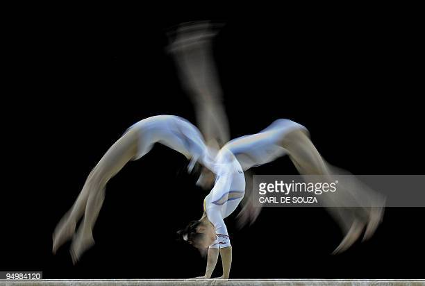 A competitor trains ahead of the Artistic Gymnastics World Championships 2009 at the 02 Arena in east London on October 12 2009 The competition runs...