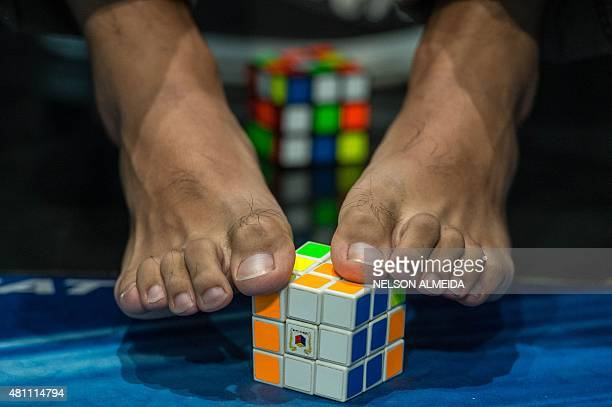 A competitor tries to solve a Rubik's cube using the feet during the Rubik's Cube World Championship in Sao Paulo Brazil on July 17 2015 400...