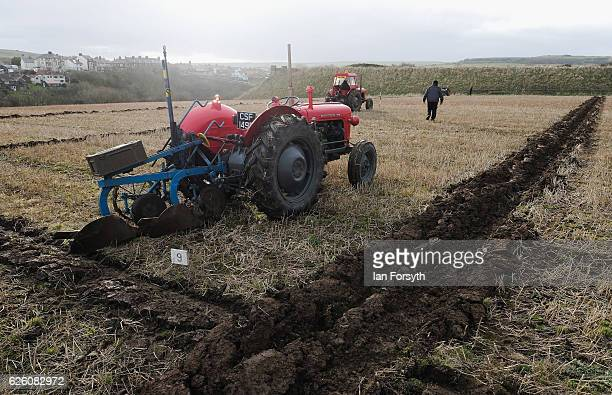 Competitor walks out to post his rig sticks that assist in keeping the furrows straight during the annual ploughing match on November 27, 2016 in...