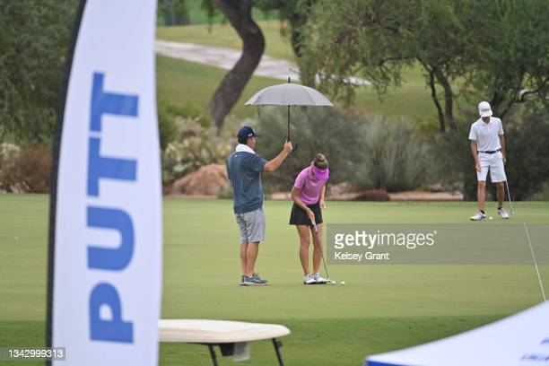 Competitor warms up on the practice putting green during the 2021 Drive, Chip and Putt Regional Qualifier at TPC Scottsdale on September 26, 2021 in...