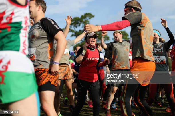Competitor warms up prior to the 2017 Tough Mudder South West at Badminton Estate on August 20 2017 in Cirencester England