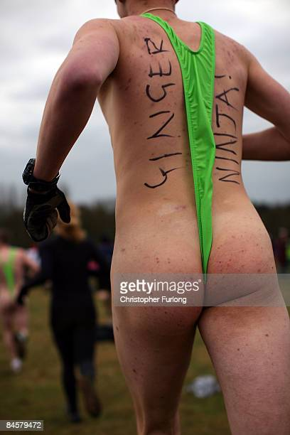 A competitor wearing a 'mankini' braves the cold while running during the Tough Guy Challenge 2009 at South Perton Farm on February 1 2009 in...