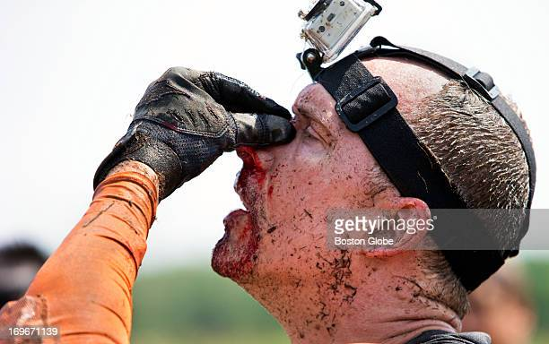 A competitor who got cut by the Electric Eel obstacle where dangling wires give off electronic shocks during a Tough Mudder event held at the Seneca...