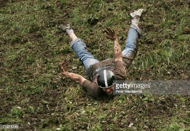 A competitorr takes part in a round of Cheese Rolling on Coopers Hill on May 29 2006 in Gloucester England The annual tradition which is thought to...