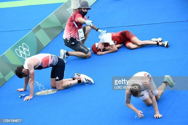 Competitors after finishing the men's individual triathlon competition during the Tokyo 2020 Olympic Games at the Odaiba Marine Park in Tokyo on July...