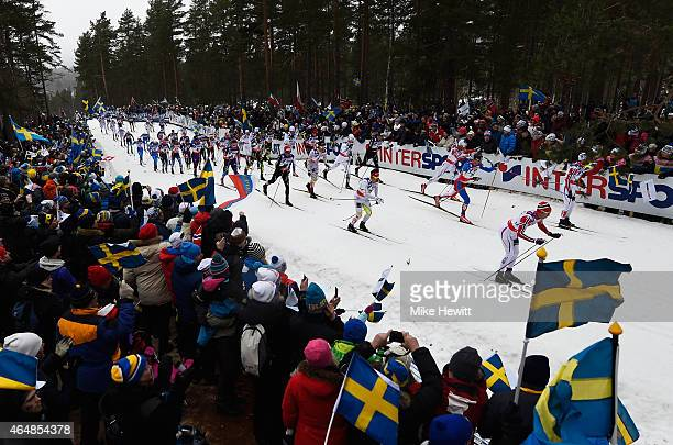 Competitors are encouraged by fans during the Men's 50km Mass Start Cross-Country during the FIS Nordic World Ski Championships at the Lugnet venue...