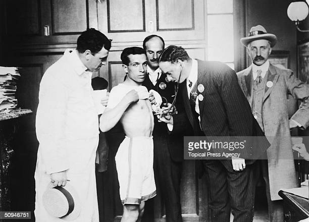 Competitors are examined by a doctor before taking part in the Marathon at the 1908 London Olympics.