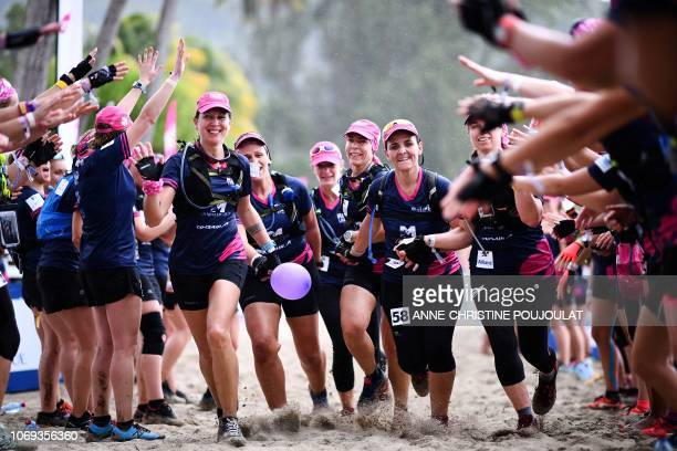 Competitors are greeted as they cross the finish line after competing in the Raid des Alizes an exclusively allfemale multi sport competition on the...