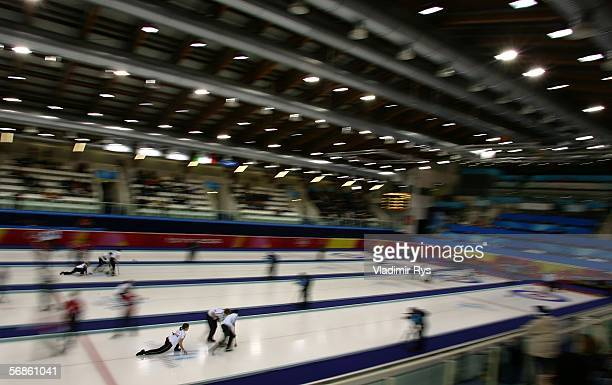 Competitors are seen during the preliminary round of the women's curling on Day 6 of the Turin 2006 Winter Olympic Games on February 16 2006 at the...
