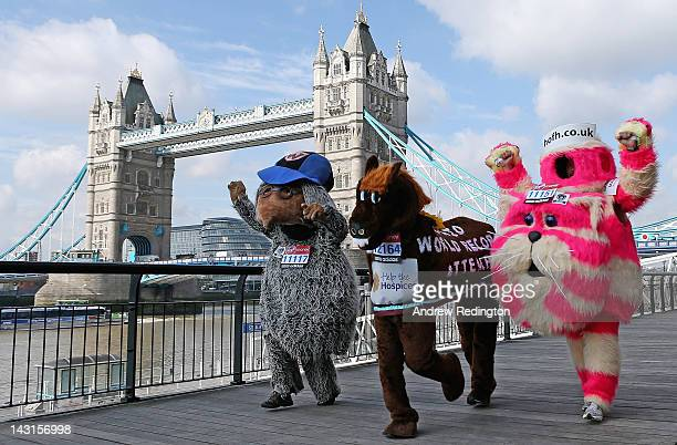 Competitors attempting to break various Guinness World Records pose in front of Tower Bridge during a photocall ahead of the Virgin London Marathon...