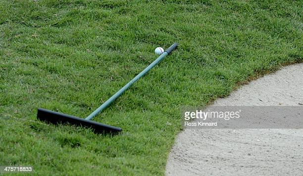 Competitors ball lays up against a rake placed outside of bunker during the third round of the HSBC Women's Champions at the Sentosa Golf Club on...