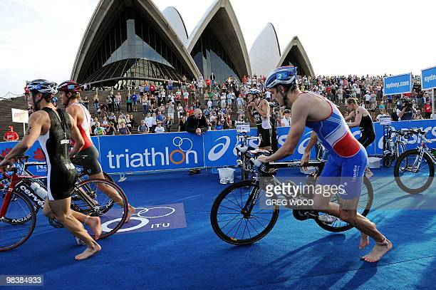 Competitors begin the bike leg of the men's event at the Sydney round of the ITU World Championship Triathlon Series elite on April 11 2010 Bevan...