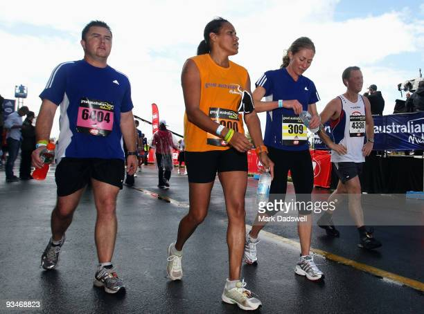 Competitors Cathy Freeman and Tiffany Cherry warm down after finishing the race during the Australian Road Running Championships and Great Australian...