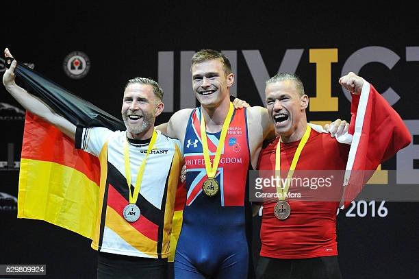 Competitors celebrate during the medals ceremony at the Invictus Games Orlando 2016 Rowing Finals at the ESPN Wide World of Sports complex on May 9,...