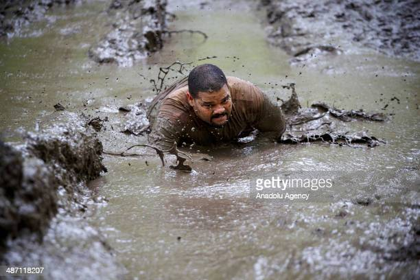 Competitors challenge in Tough Mudder endurance race in HenleyonThames England on 27 April 2014 Competitors run a 19km course designed by British...