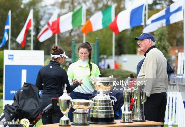 Competitors check the balls they're playing on first tee during the final round of the Girls' U16 Open Championship at Fulford Golf Club on April 29...