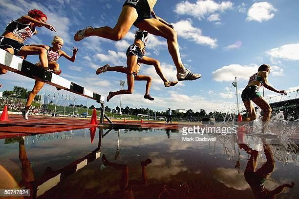 Competitors cleat the water jump in the Women's 3000 Metres Steeplechase during day four of the Athletics Australia Telstra Aseries National...