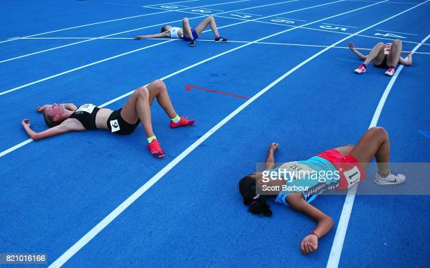 Competitors collapse exhausted on the track after competing in the Girls 3000m Final at the Athletics on day 5 of the 2017 Youth Commonwealth Games...