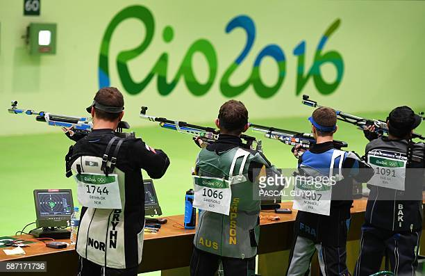 Competitors compete during the 10m Air Rifle Men's at the Olympic Shooting Centre in Rio de Janeiro on August 8 during the Rio 2016 Olympic Games /...