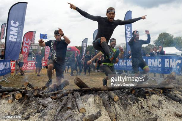 Competitors cross the finish line during the Paris Spartan Race at Jablines Park on September 22 2018 in Jablines France