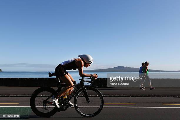 Competitors cycle along Tamaki Drive during Ironman 700 on January 18 2015 in Auckland New Zealand