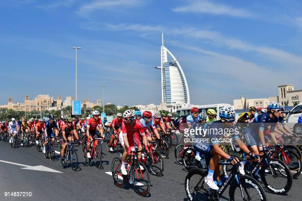 Competitors cycle past the Burj alArab as they compete in the first stage of the Dubai Tour from Sky Dive Dubai to Palm Jumeirah in Dubai on February...