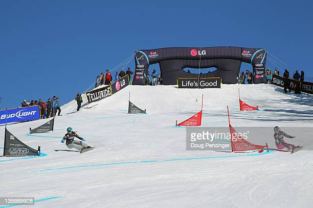 Competitors descend the course during the parallel giant slalom at the LG Snowboard FIS World Cup on December 15 2011 in Telluride Colorado