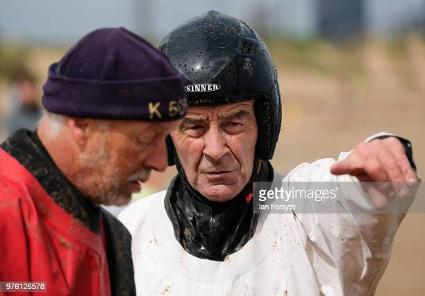 Competitors discuss tactics as they prepare to race in the National Land Sailing regatta held on Coatham Sands on June 16, 2018 in Redcar, England....
