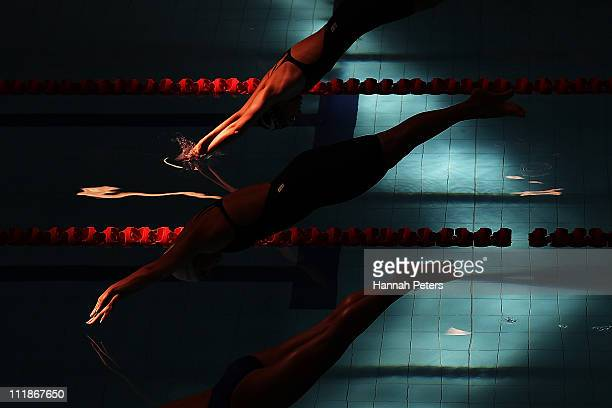 Competitors dive in for the start of the Women's 400m individual medley during the New Zealand Open Swimming Championships at West Wave Aquatic...