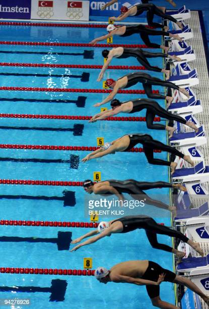 Competitors dive into the pool during the men's 400m freestyle heats at the European Short Course Swimming Championship in Istanbul on December 10...