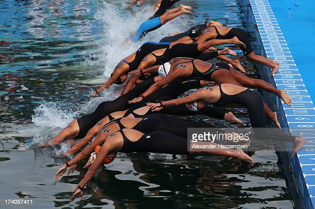 Competitors dive into the water at the start of the Open Water Swimming Women's 5k race on day one of the 15th FINA World Championships at Moll de la...