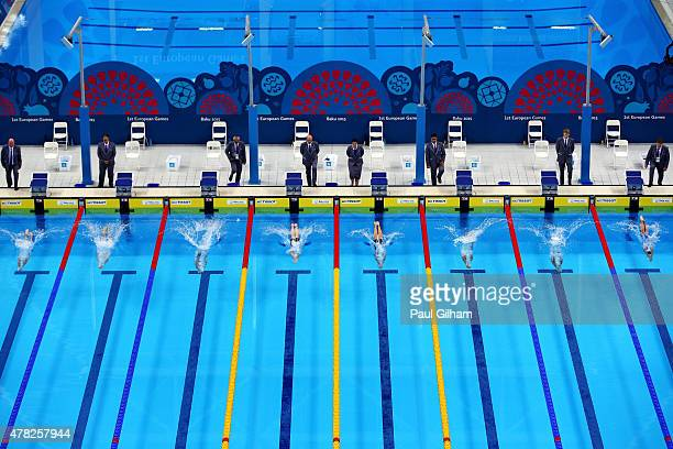 Competitors dive into the water at the start of Women's 200m Breaststroke semi final during day twelve of the Baku 2015 European Games at the Baku...