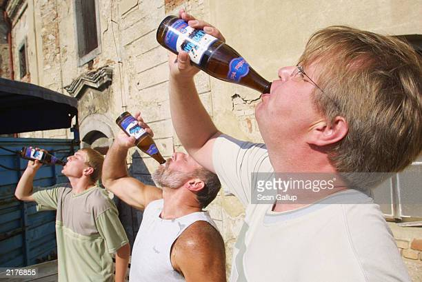 Competitors down a bottle of lager July 19 2003 during a beer drinking competition at the Herold Brewery in Breznice Czech Republic Pub life and beer...