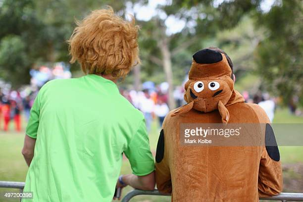 Competitors dressed as Shaggy and Scooby Doo watch on as they wait to compete during the 2015 Red Bull Billy Cart Race at Centennial Park on November...